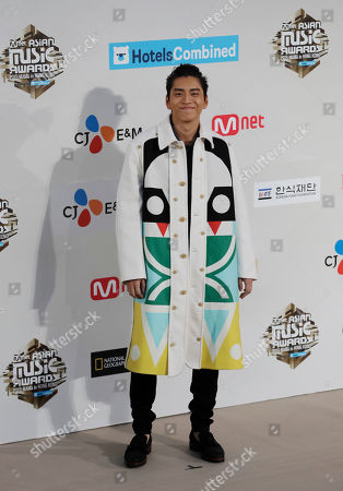 Taiwanese actor Darren Wang poses for photos on the red carpet of the 2016 Mnet Asian Music Awards (MAMA) in Hong Kong