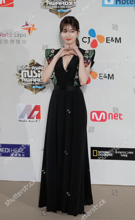 South Korean singer Suzy Bae, member of K-Pop girl group miss A, poses for photos on the red carpet of the 2016 Mnet Asian Music Awards (MAMA) in Hong Kong
