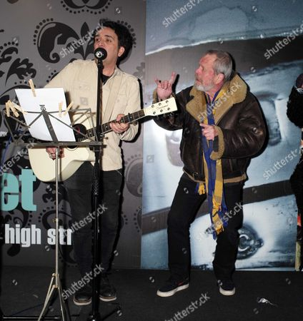 Stock Image of 23 11 15 Terry Gilliam Turns On the Christmas Light in Berwick Street Market Soho Terry Gilliam with Local Singer Song Writer Tim Arnold Sing Always Look On the Bright Side of Life