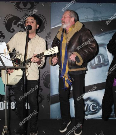 Stock Picture of 23 11 15 Terry Gilliam Turns On the Christmas Light in Berwick Street Market Soho Terry Gilliam with Local Singer Song Writer Tim Arnold Sing Always Look On the Bright Side of Life