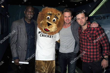 27 07 15 Death of A Gentleman Film Premiere at Picture House Central Shaftesbury Ave Piccadilly London Cricket Mascot Hansie the Lion with Michael Holding Nick Compton and Harry Judd