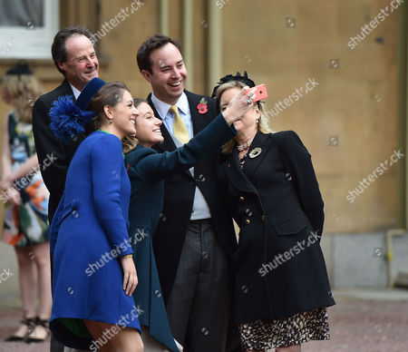 Stock Photo of 10 11 15 Investiture at Buckingham Palace at Buckingham Palace Nma Rota For the Daily Mail the Most Excellent Order of the British Empire Civil Division to Mr James Murray Wells with His Wife Lottie Fry For Services to Business