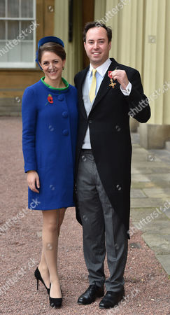 Stock Picture of 10 11 15 Investiture at Buckingham Palace at Buckingham Palace Nma Rota For the Daily Mail the Most Excellent Order of the British Empire Civil Division to Mr James Murray Wells with His Wife Lottie Fry For Services to Business