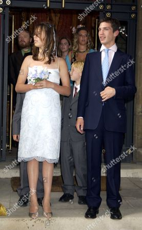 Disgraced Ex-tory Minister Jonathan Aitken Has Married For the Second Time at A Low-key Service in London Mr Aitken Who Was Jailed For Perjury After His Doomed Libel Action Against the Guardian and Granada Television Wed Elizabeth Harris the Former Wife of the Late Actor Richard Harris the Smiling Pair Posed with Family His 4 Children & Her 3 Sons On the Steps St Matthews Church Westminster London They Were Then Driven to the Reception in Carlton Terrace Central London in A Blue Mercedes Before Beginning Their Honeymoon with A Night at London's Ritz Hotel Ther Bride and Groom Would Spend Just One Night in the London Hotel Before Flying to the Caribbean For the Rest of Their Honeymoon Ella Harris & William Aitken Afer the Service Watch the Bride & Groom Leave