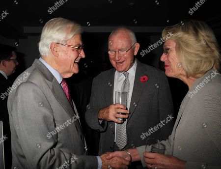 02 11 15 Launch Party For Charles Moore's New Book ' Margaret Thatcher the Authorised Biography Volume Two: ' at M&c Saatchi Golden Square Soho Lord Kenneth Baker with Lord John Birt with His Wife Eithne Wallis