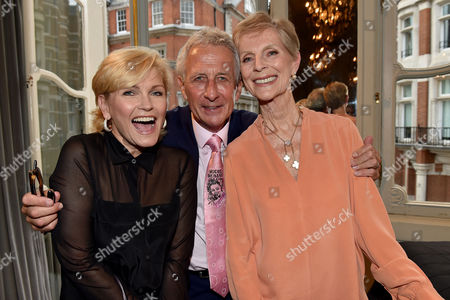 Stock Picture of 16 07 15 Launch of Robert Lacey's New Book Model Woman: Eileen Ford and the Business of Beauty at the Savile Club Brook Street Mayfair London Fiona Fullerton Robert Lacey & Paulene Stone