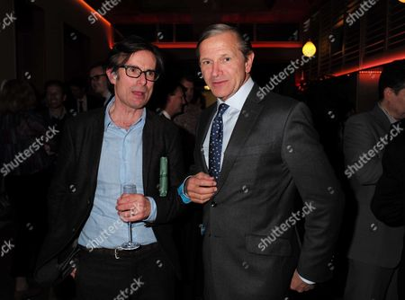 Stock Photo of 23 11 15 Robert Peston Bbc Leaving Party at the Kings Fund Cavendish Square Robert Peston with Marc Bolland Ceo of Marks & Spencer