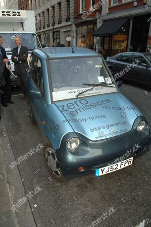 Private View at the Cork Street Gallery of ' Soft' Archie Norman with His Electric Car
