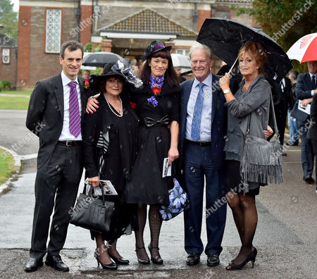 13 08 15 the Funeral of George Cole at Reading Crematorium George Coles Widow Penny Morrell with Their Children Toby and Tara Cole with Dennis Waterman and His Wife Pam Flint