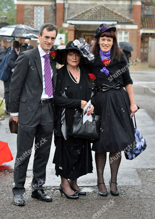 13 08 15 the Funeral of George Cole at Reading Crematorium George Coles Widow Penny Morrell with Their Children Toby and Tara Cole