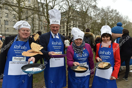 09 02 16 the Rehab Parliamentary Pancake Race at Victoria Tower Gardens Millbank Westminster London Lord Kennedy Lord St John of Bletso Baroness Susan Kramer & Baroness Parminter