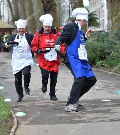 09 02 16 the Rehab Parliamentary Pancake Race at Victoria Tower Gardens Millbank Westminster London Alan Duncan Mp Lord Redesdle and Nigel Nelson