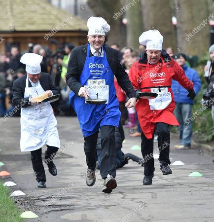Stock Image of 09 02 16 the Rehab Parliamentary Pancake Race at Victoria Tower Gardens Millbank Westminster London Alan Duncan Mp Lord Redesdle and Nigel Nelson
