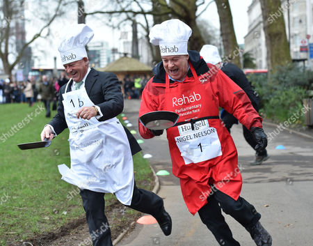 09 02 16 the Rehab Parliamentary Pancake Race at Victoria Tower Gardens Millbank Westminster London Alan Duncan Mp and Nigel Nelson