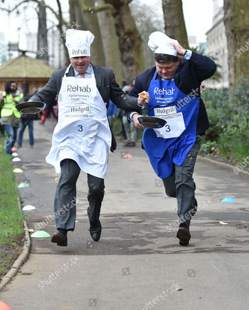 09 02 16 the Rehab Parliamentary Pancake Race at Victoria Tower Gardens Millbank Westminster London Tim Loughton Mp & Lord Addington
