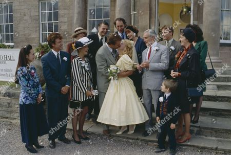 Malandra Burrows (as Kathy Merrick) and Peter Amory (as Christopher Tate) wedding day, featuring other cast members including Norman Bowler (as Frank Tate), Clive Hornby (as Jack Sugden), Claire King (as Kim Tate), Cy Chadwick (as Nick Bates) Tom Adams (as Malcolm Bates). (Episode 1606 - 5th November 1991)