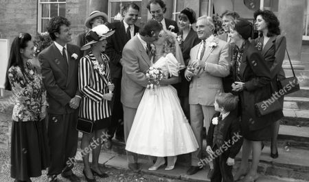 Behind the scenes filming of Malandra Burrows (as Kathy Merrick) and Peter Amory (as Christopher Tate) wedding day, with cast and crew, featuring Norman Bowler (as Frank Tate), Clive Hornby (as Jack Sugden), Claire King (as Kim Tate), Cy Chadwick (as Nick Bates), - Cy Chadwick and Tom Adams (as Malcolm Bates). (Episode 1606 - 5th November 1991)