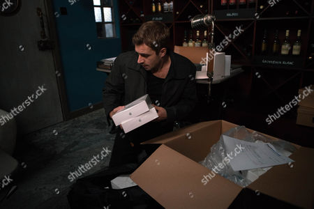 Andy Carver, as played by Oliver Mellor, needs money as he desperately tries to avoid the police learning about his attack on Phelan. Noting the extra tablets Steph has accidentally ordered to the bistro, Andy comes up with a plan. Hating himself Andy checks there's no one about before letting himself into the bistro and stealing the box of tablet computers. (Episode 9061 - Mon 19th Dec 2016)