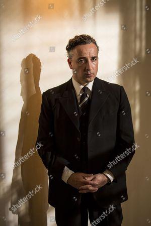 Aidan McArdle as Judge Comeliau.
