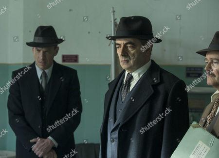 Rowan Atkinson as Maigret and Shaun Dingwall as Janvier.