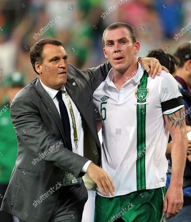 Ireland assistant coach Marco Tardelli comforts Richard Dunne at the final whistle at the Municipal Stadaium, Poznan