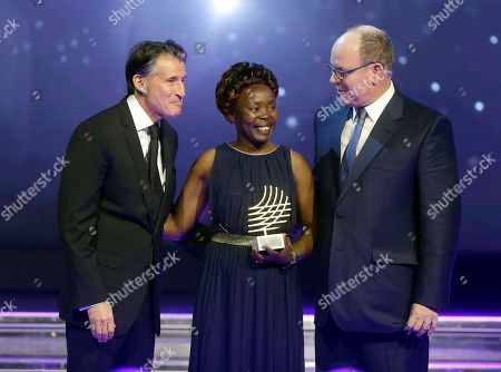 Tegla Loroupe, Prince Albert II of Monaco, Sebastian Coe Prince Albert II of Monaco, right, and President of the International Association of Athletics Federations (IAAF) Sebastian Coe, left pose with Kenyan former marathon world record-holder Tegla Loroupe who was presented with the 2016 President Award, during the 2016 World Athletics Gala Awards, in Monaco