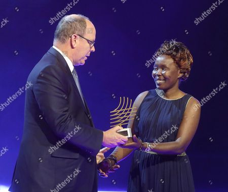 Tegla Loroupe Prince Albert II of Monaco Prince Albert II of Monaco, left, presents Kenyan former marathon world record-holder Tegla Loroupe with the 2016 President Award, during the 2016 World Athletics Gala Awards, in Monaco