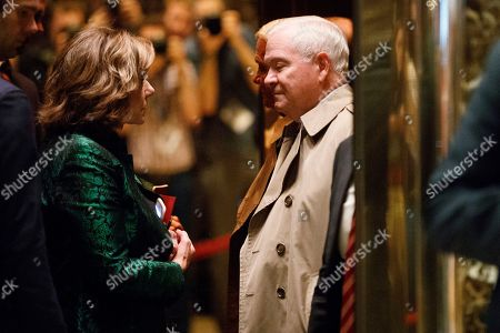 KT McFarland, Robert Gates K.T. McFarland, Deputy National Security Advisor for President-elect Donald Trump, left, gets on an elevator with former Secretary of Defense Robert Gates in the lobby of Trump Tower, in New York