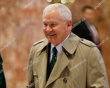 Former Secretary of Defense Robert Gates arrives in the lobby of Trump Tower for a meeting with President-elect Donald Trump, in New York