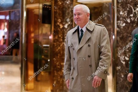 Former Secretary of Defense Robert Gates walks to speak with reporters after a meeting with President-elect Donald Trump at Trump Tower, in New York