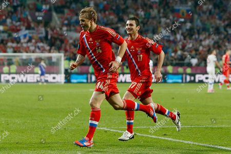 Roman Pavlyuchenko of Russia celebrates his goal with Alan Dzagoev at the Municipal Stadium, Wroclaw