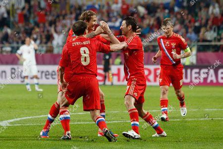 Roman Pavlyuchenko celebrates with goal scorer Alan Dzagoev of Russia at the Municipal Stadium, Wroclaw