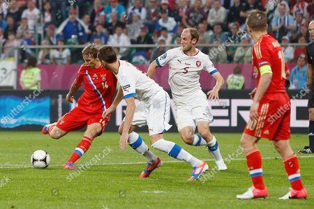 Roman Pavlyuchenko of Russia strikes to score his sides fourth goal at the Municipal Stadium, Wroclaw