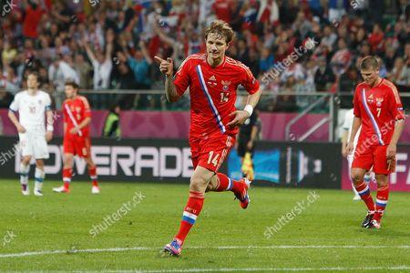 Roman Pavlyuchenko of Russia celebrates scoring his sides fourth goal at the Municipal Stadium, Wroclaw