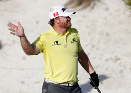 J. B. Holmes J.B. Holmes gestures after his tee shot went right on the 16th hole during the second round at the Hero World Challenge golf tournament, in Nassau, Bahamas