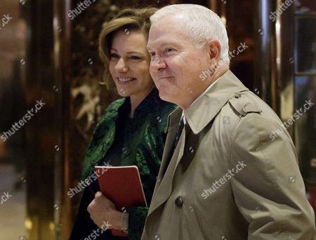 Former Defense United States Secretary of Defense Robert Gates (R) walks with K.T. McFarland (L), President-elect Donald Trump's Deputy National Security Advisor, through the lobby of Trump Tower