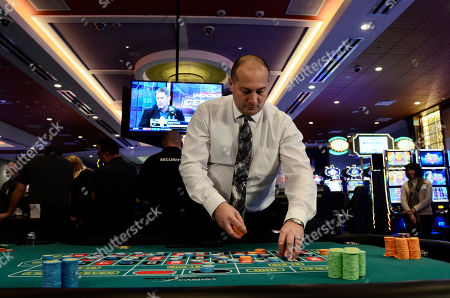 BC-US--New York Casino Gamble Tioga Downs Director of Casino Operations, Mike Chapman, simulates a roulette game during a media tour before the official opening of the new gaming floor, in Nichols, N.Y. The first of four planned casinos opened with a flurry of balloons, confetti and uncertain visions of economic resurgence on Friday as New York ushered in a new era of state-sanctioned gambling aimed at reversing decades of upstate decline