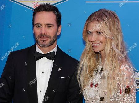 Jimmie Johnson, left, and wife Chandra Johnson pose on the red carpet before the NASCAR Sprint Cup Series auto racing awards, in Las Vegas