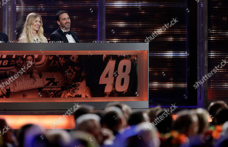 Jimmie Johnson and his wife, Chandra Johnson, sit on stage during the NASCAR Sprint Cup Series auto racing awards, in Las Vegas