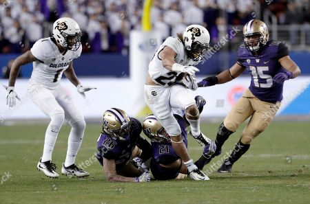 Stock Image of Phillip Lindsay, Taylor Rapp Colorado running back Phillip Lindsay, center, is tackled by Washington defensive back Taylor Rapp (21) during the first half of the Pac-12 Conference championship NCAA college football game, in Santa Clara, Calif