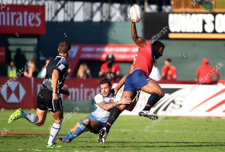 France's Terry Bouhraoua tackles Scotland's Joe Nayacavou in the fifth place semi-final during the World Rugby Sevens Series. France lost 17-26 to Scotland in Dubai, the United Arab Emirates