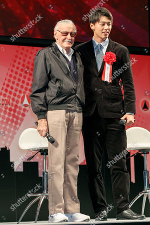 Stan Lee (L) and actor Ryoma Takeuchi (R)