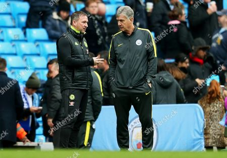 Chelsea first team coach Steve Holland talks with Manchester City Assistant coach Brian Kidd before the game