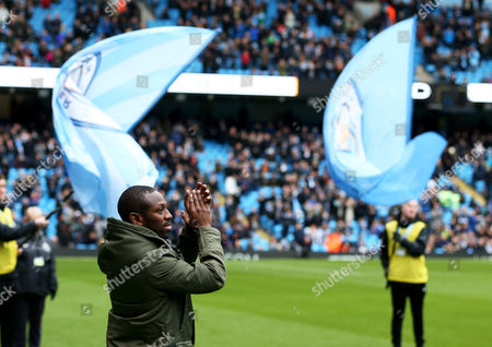 Former Manchester City and Chelsea player Shaun Wright-Phillips greets the crowd before kick off