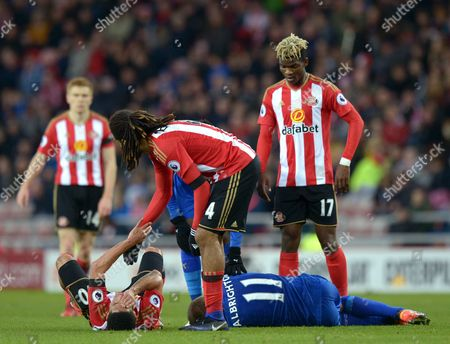 Steven Pienaar of Sunderland (2nd from left) holds his face after clashing with Marc Albrighton (2nd from right) during the Premier League match between Sunderland and Leicester City played at Stadium of Light, Sunderland on 3rd December 2016