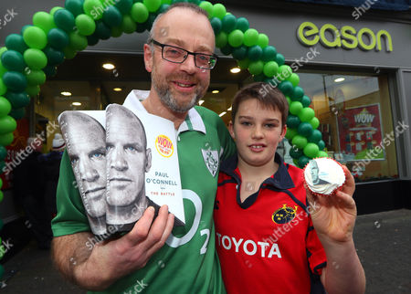 Paul O'Connell Book Signing, Eason, O'Connell Street, Limerick 3/12/2016. Patrick and Cormac Rowe from Killarney, Kerry pictured at Eason O?Connell Street in Limerick for the signing of Paul O'Connell's highly acclaimed autobiography, ?The Battle?. . There has never been a rugby player quite like Paul O'Connell. He is synonymous with passion, heart and determination; but he is also the thinking man's rugby player, a legendary student of the game. As the heartbeat of Munster, British and Irish Lions captain in 2009, and captain of the first Ireland team to defend a Six Nations championship, O'Connell has emerged as perhaps the most beloved of the golden generation of Irish rugby players. The book can be purchased on www.easons.com