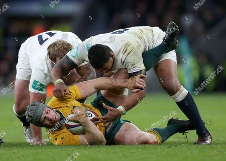 Nathan Hughes of England, and Joe Marler, both smash David Pocock of Australia backwards during the tackle during the Old Mutual Wealth Series match between England and Australia played at Twickenham Stadium, London on 3rd December 2016