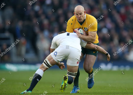 Stephen Moore (Captain) of Australia is tackled by Tom Wood of England during the Old Mutual Wealth Series match between England and Australia played at Twickenham Stadium, London on 3rd December 2016