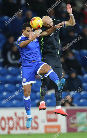 Bruno Saltor of Brighton and Kieran Richardson of Cardiff City compete for the ball