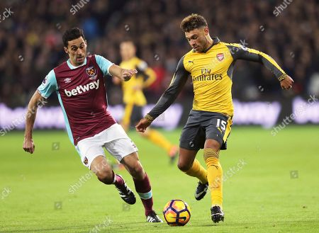 West Ham's Alvaro Arbeloa, left, competes for the ball with Arsenal's Alex Oxlade-Chamberlain during the English Premier League soccer match between West Ham United and Arsenal at The London Stadium in London
